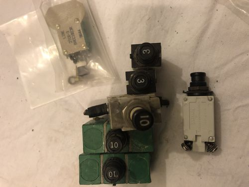 Set of 7 real cockpit circuit breakers